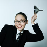Crazy business woman saluting. Studio shot portrait of one caucasian young crazy business woman saluting with funnel Royalty Free Stock Photos