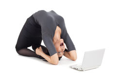 Crazy business woman in yoga pose cry on laptop Royalty Free Stock Photography