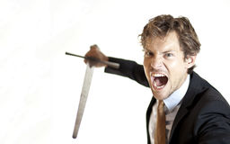 Crazy businessman attacking with sword. Warmongering businessman attacking with sword Royalty Free Stock Images