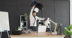 Businessman dancing and throwing his coat at office stock footage