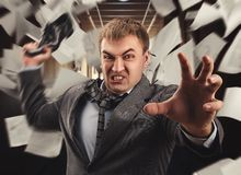 Crazy businessman is fighting in office. Aggressive office worker put up a fight with a shoe Royalty Free Stock Images