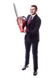 Crazy Businessman holding a chainsaw Stock Photos