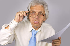 Crazy Businessman. Keep a pen and paper Royalty Free Stock Image