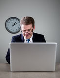 Crazy Businessman on Laptop Computer Stock Photo