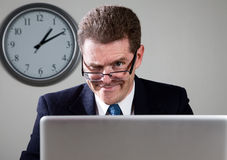 Crazy Businessman on Laptop Computer Royalty Free Stock Photos