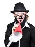 Crazy businessman making megaphone announcement. Isolated mad scientist making announcement through rolled up megaphone. Science communication over white Royalty Free Stock Image