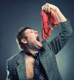 Crazy businessman with meat Royalty Free Stock Image