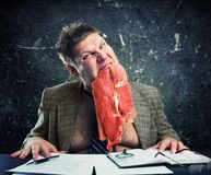 Crazy businessman with meat Royalty Free Stock Photos