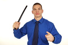 Crazy businessman with police baton Royalty Free Stock Images