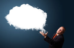 Crazy businessman presenting abstract cloud copy space Stock Images
