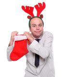 Crazy businessman with rudolph reindeer attire. Royalty Free Stock Photo