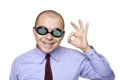 Crazy businessman with swimming goggles. Isolated on white royalty free stock photo