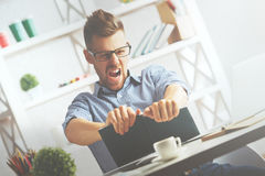 Crazy businessman tearing organizer apart Stock Images
