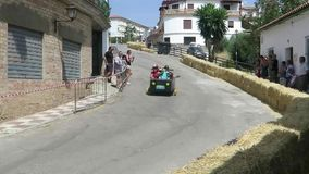 Crazy car race in Andalusian village stock footage
