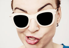 Crazy caucasian glamour woman with stylish sunglasses Stock Images