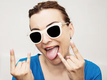 Crazy caucasian woman with horns hands sign Royalty Free Stock Photography