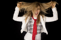 Crazy caucasian young female excited pulling her hair Stock Photos
