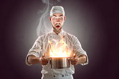 Crazy chef. Cooking with his passion Stock Photo
