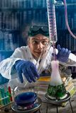 Crazy chemist doing experiment stock images
