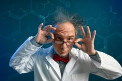 Crazy chemist professor in the lab stock image