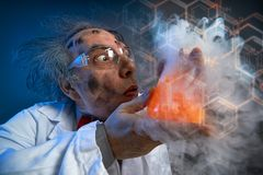 Crazy chemist with test-tube stock photography