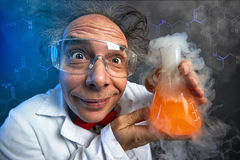 Crazy chemist with test tube stock image