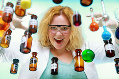 Crazy chemist woman with chemical glassware flask Royalty Free Stock Photography