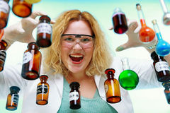 Crazy chemist woman with chemical glassware flask Royalty Free Stock Images