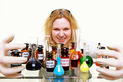 Crazy chemist woman with chemical glassware flask isolated Stock Image