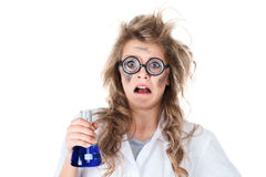 Crazy chemist. Woman with disheveled hair and vial in hands Stock Photos