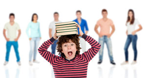 Crazy child with books on his head Stock Image