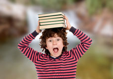 Crazy child with books on his head Royalty Free Stock Photo