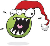 Crazy Christmas monster wearing a Santa hat Stock Photography