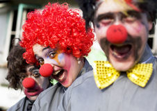 Crazy Circus Clowns. Focus On The Faces Of 3 Crazy Circus Clowns At An Outdoor Birthday Gig Clowning Around In A Funny And Comical Show Of Entertainment Royalty Free Stock Images