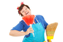 Crazy Cleaning Lady. Cleaning lady with a crazy expression plays with her broom and feather duster. Isolated on white stock photography