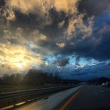 Dramatic, Stormy Highway. Michigan is known for very beautiful skies because of its close proximity to many lakes royalty free stock image