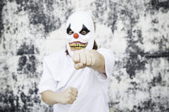 Crazy clown attack. Crazy clown mask halloween costume and fear stock photo