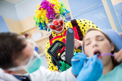 Crazy clown with chainsaw Royalty Free Stock Photos