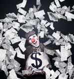 Crazy Clown Excited To Hold A Bag Of Money Stock Photography