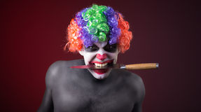 Crazy clown  with a knife Stock Photo