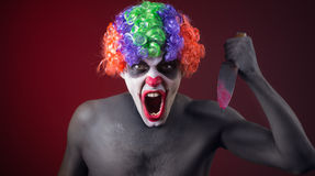 Crazy clown  with a knife Stock Image