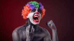 Crazy clown  with a knife Royalty Free Stock Images