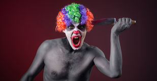 Crazy clown  with a knife Stock Photos