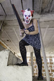 Crazy clown saw. Crazy clown with saw, murderer and halloween royalty free stock photo