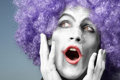 Crazy clown singing. Happy mad clown singing song on a blue background Royalty Free Stock Photos
