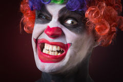 Crazy clown a terrible death Royalty Free Stock Image