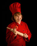 Crazy cook. Woman baker with rolling pin gritted teeth Royalty Free Stock Photography