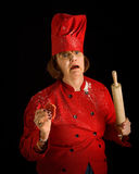 Crazy cook. Woman baker with rolling pin Royalty Free Stock Photo