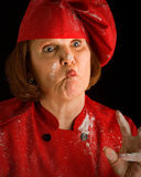 Crazy cook. Woman baker with pinched lips Stock Photography