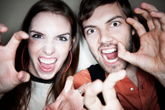 Crazy Couple. Using their Hands as Claws Royalty Free Stock Photo